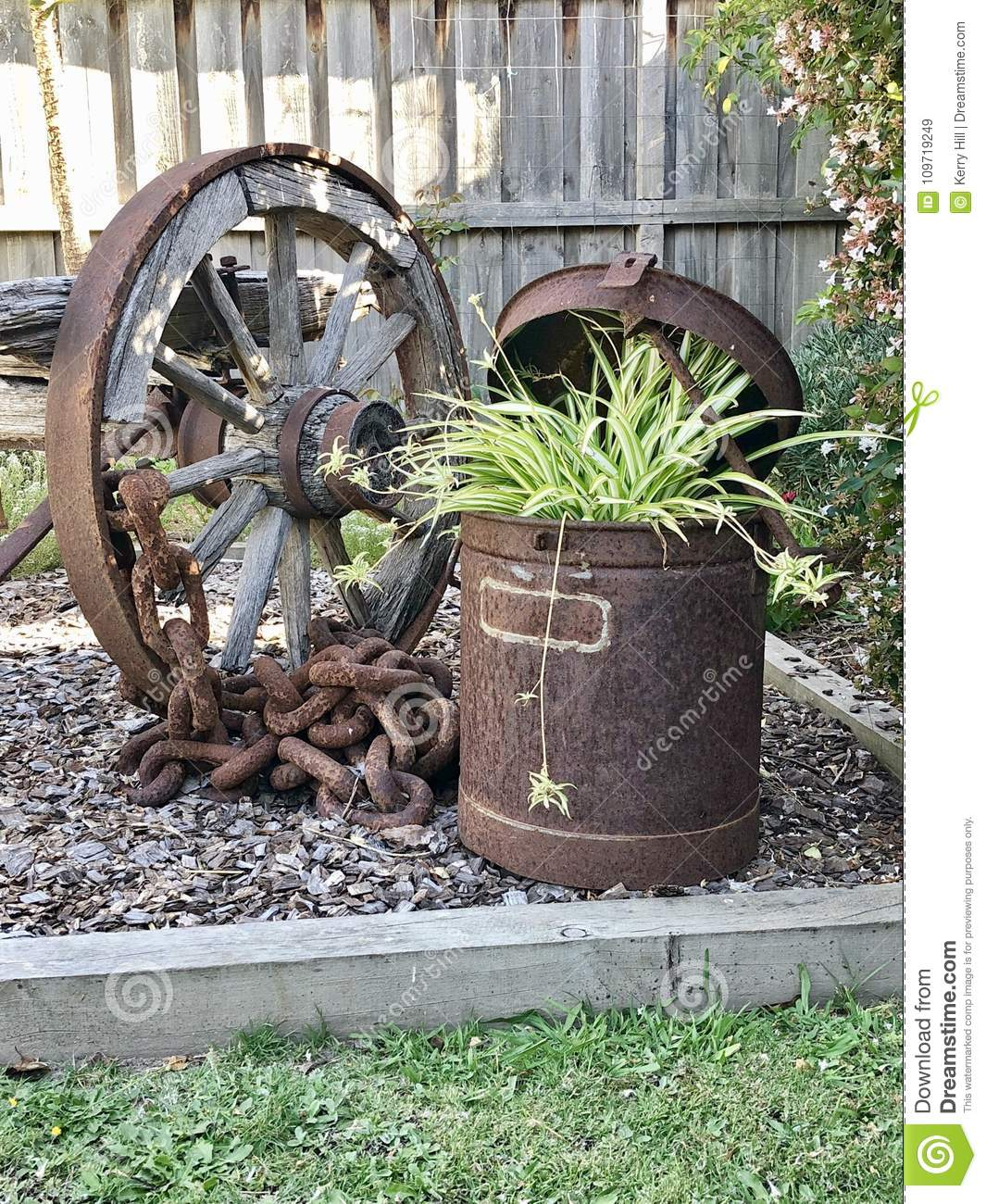 Old Rustic Wagon Wheel And Planter Stock Image Image Of Equipment Wooden 109719249