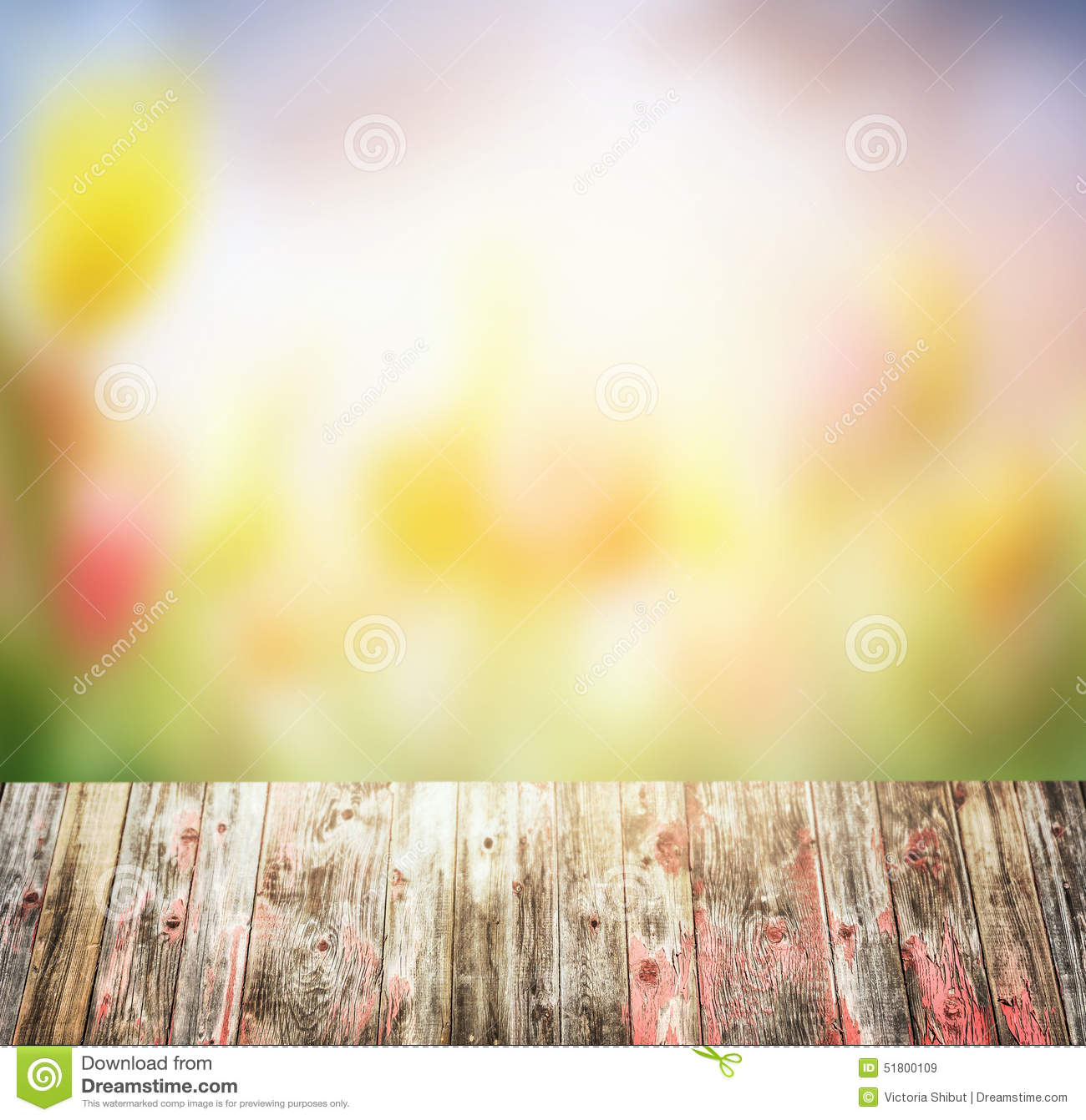 ... Photo: Old rustic Wooden table over blurred flowers garden background
