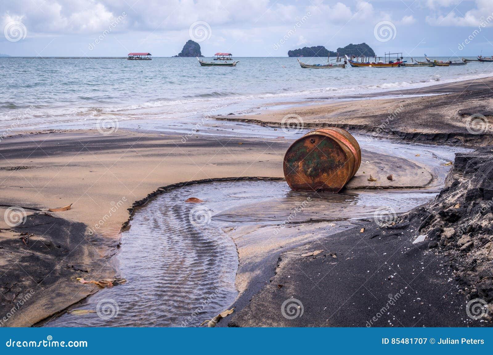 Old rusty barrel oil on beach in Asia