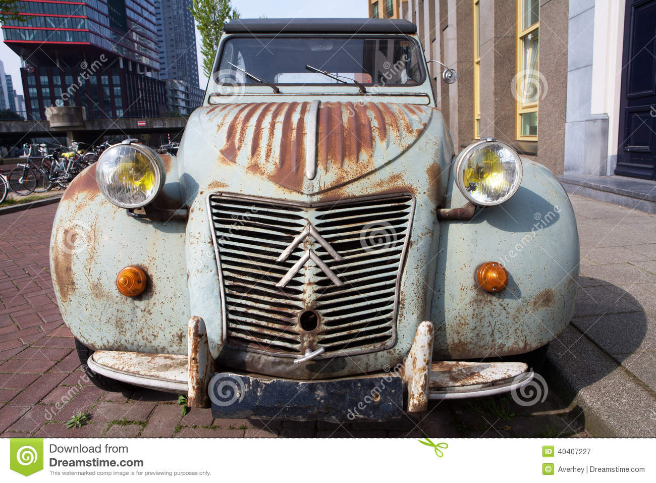 old rusty citroen 2cv in the city editorial photography