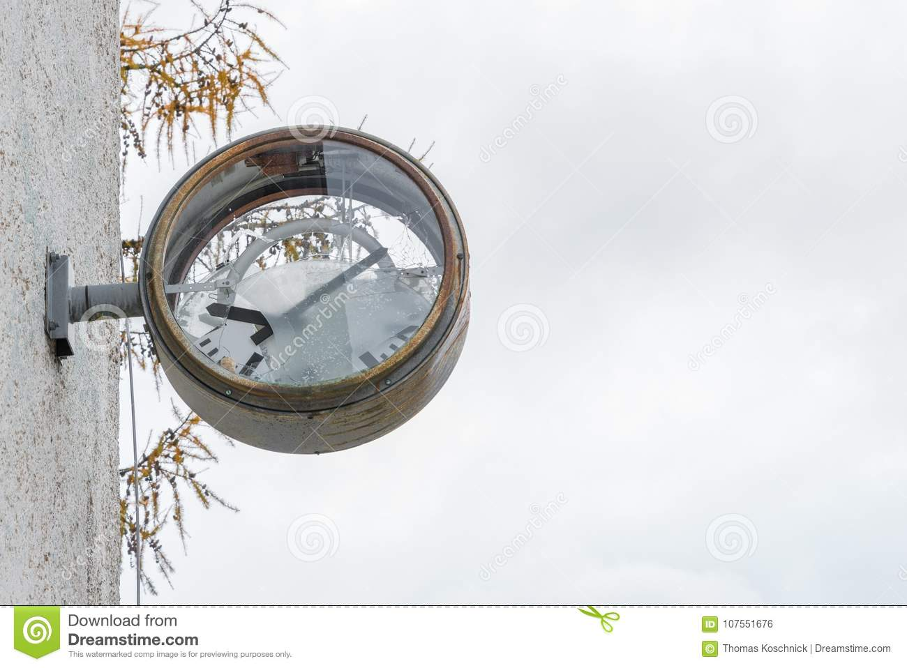 Old rusty clock with broken glass and dial