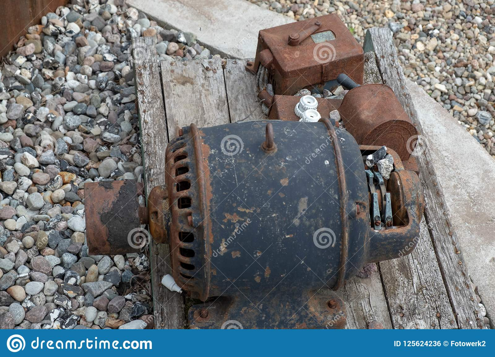 An Old, Rusty Engine Lies On A Board. Stock Photo - Image ...