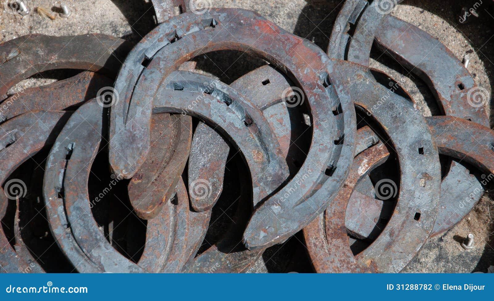 Old rusty horseshoes background stock photo image of blacksmith royalty free stock photo biocorpaavc Choice Image