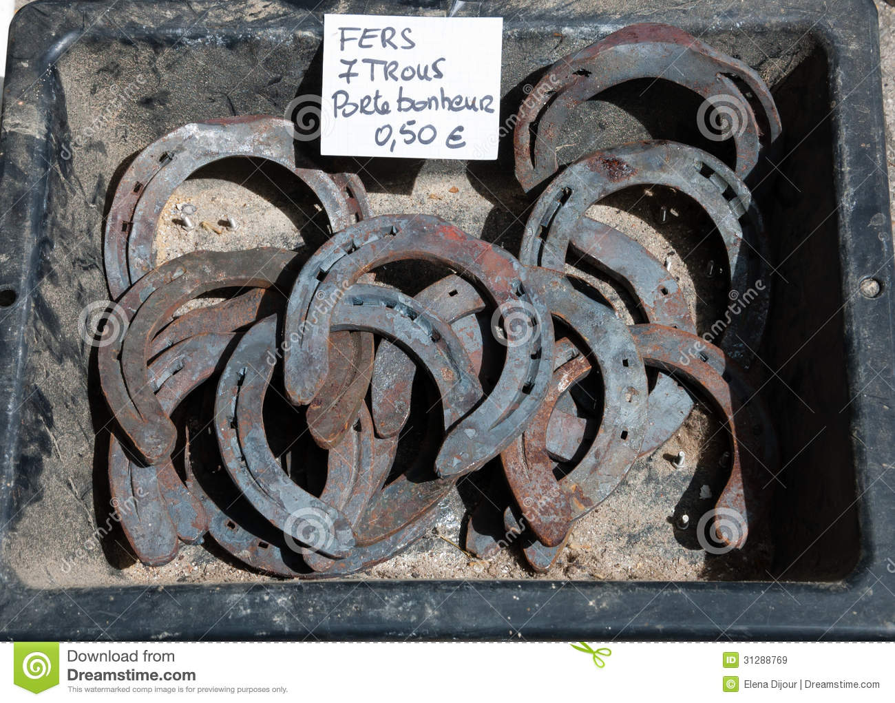 old rusty horseshoes for sale at flea market royalty free