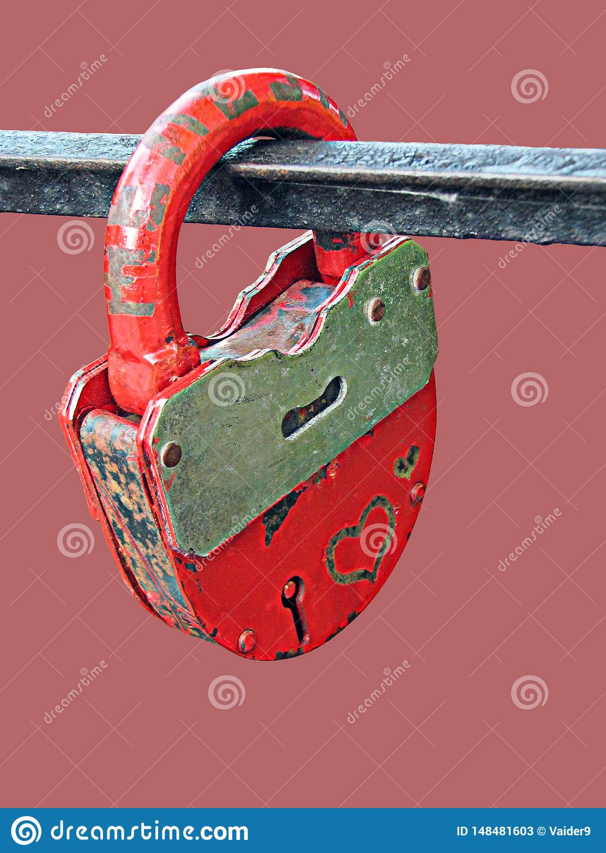 Old rusty iron padlock on pink background