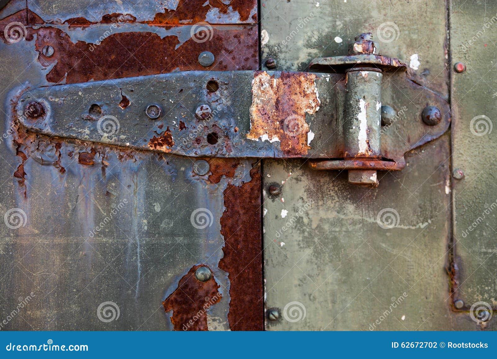 Rusty Metal Door old rusty metal hinge on the metal door stock photo - image: 62672702