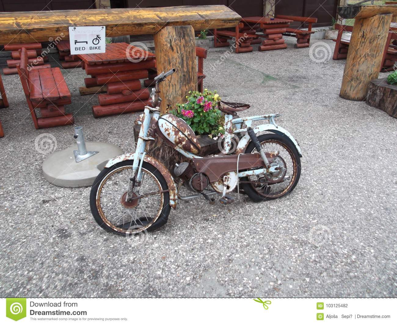 The Old rusty motorbike serving as a decoration