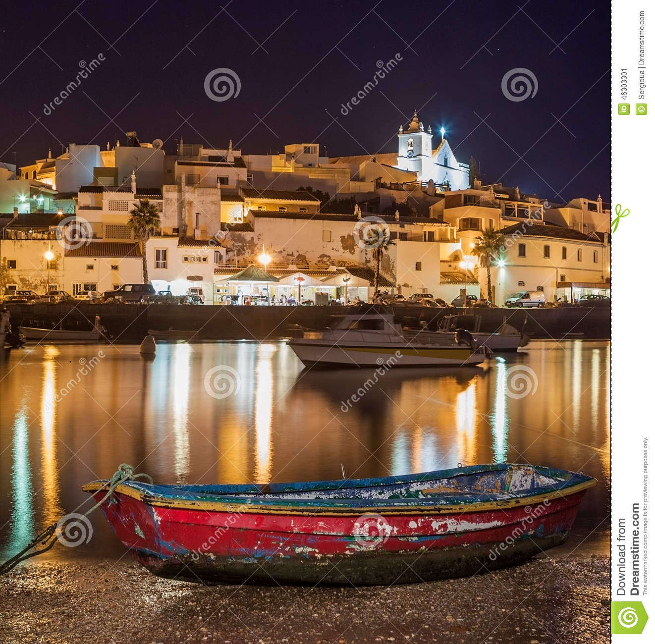 Old sea town of Ferragudo in lights at night.