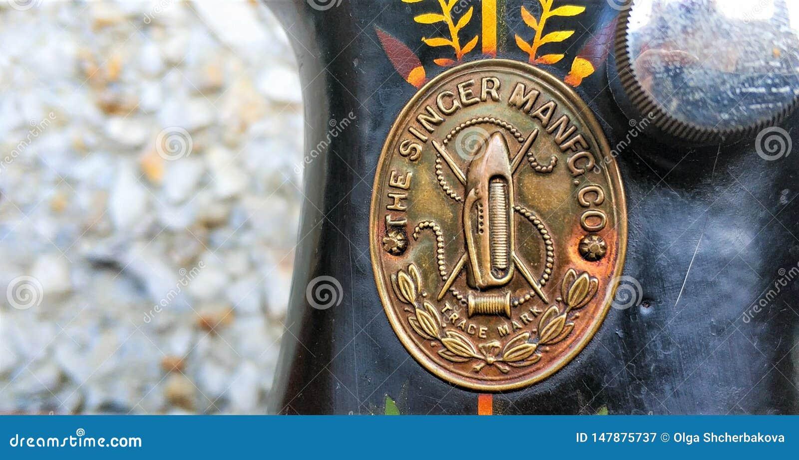 Old sewing machine vintage retro close up. Singer Factory Emblem