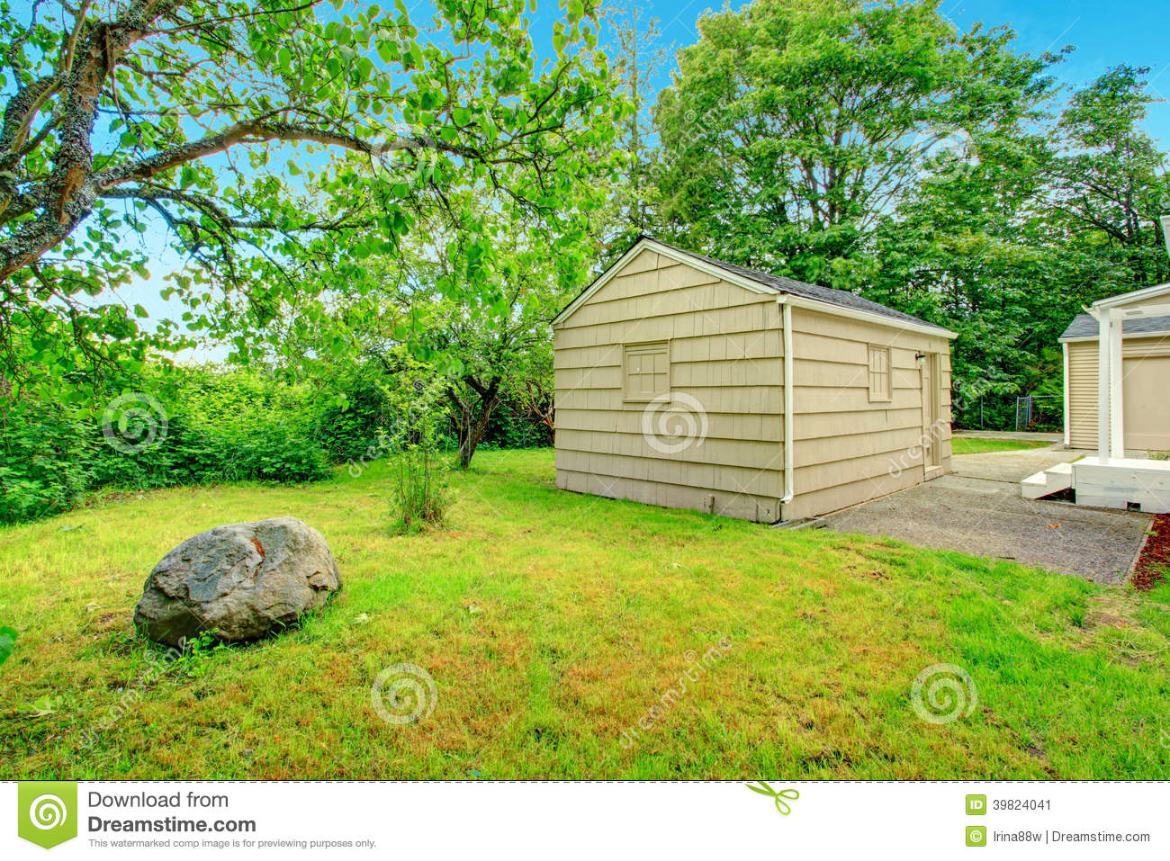 Old small fixer upper house backyard view stock photo for Garden shed fixer upper