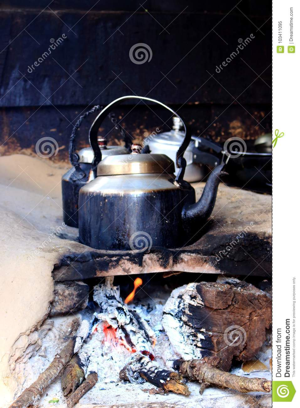 Old Smoked Metal Pot On Wooden Fireplace While Cooking Indian Tea