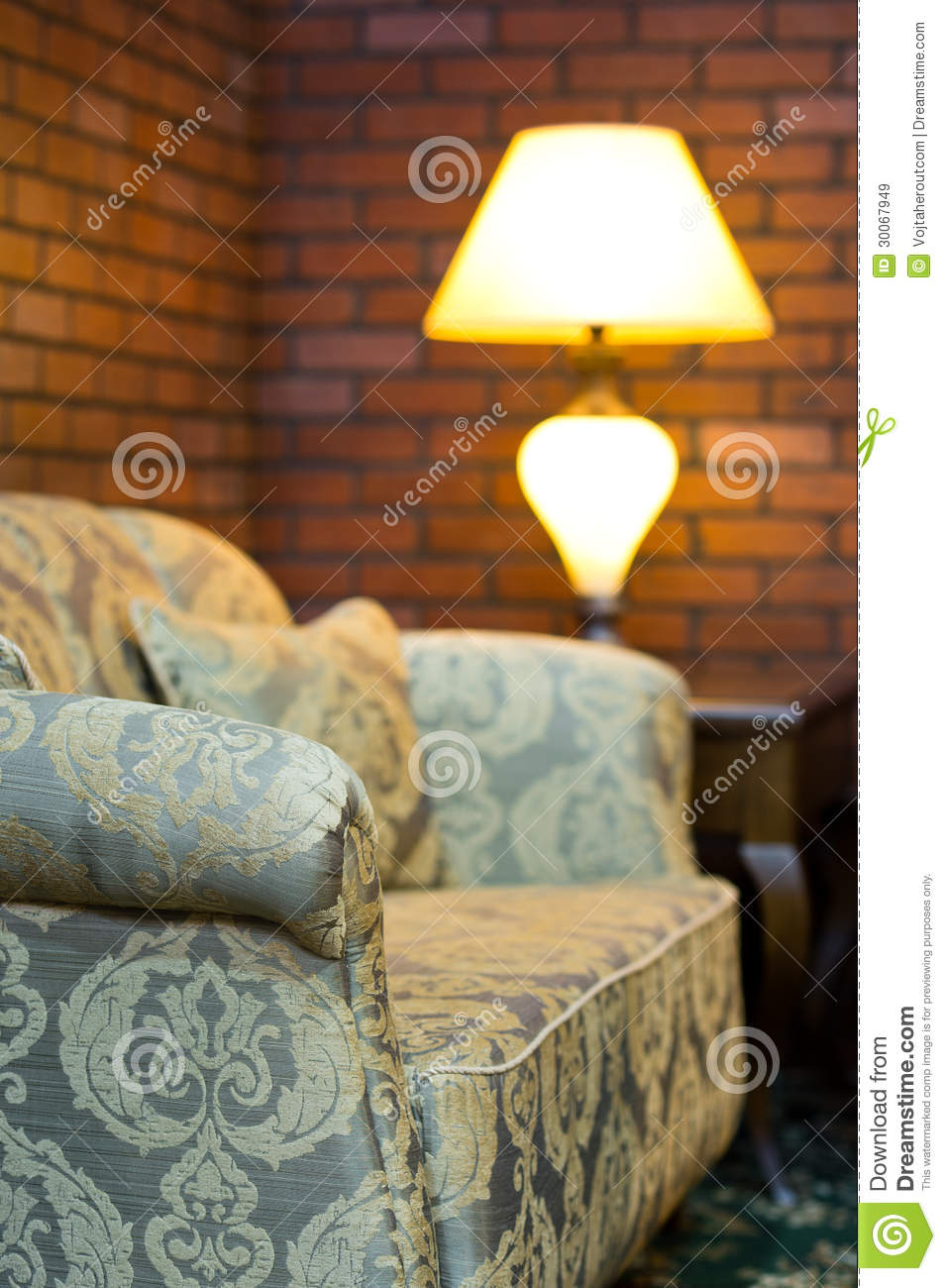 Old Sofa In A Living Room With Red Brick Wall Decor Stock