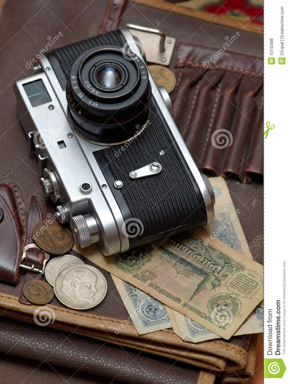Old soviet film camera and money