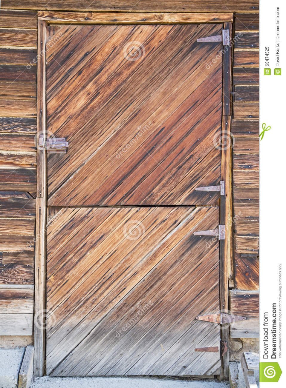 door into the western hay livestock barn has rusty hinges and door ...