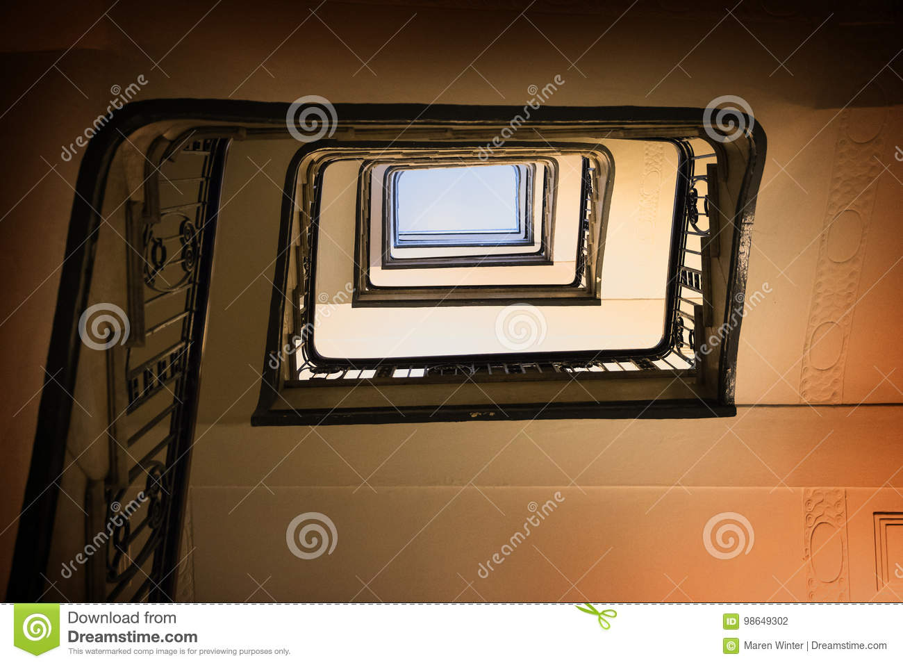 Old square spiral stairway case from below