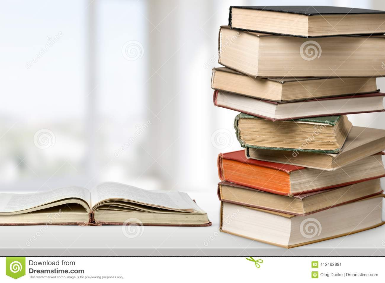 old stacked books on light background stock image image of story