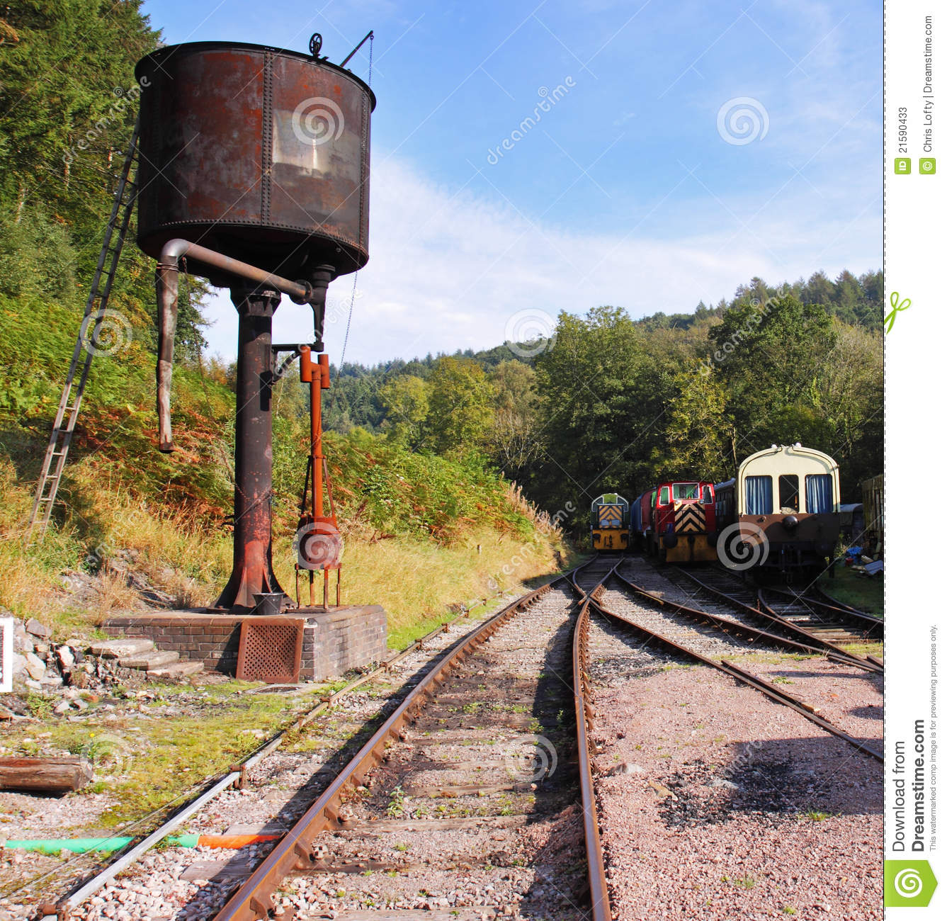 Old Steam Railroad Tracks And Rusting Water Tower Stock