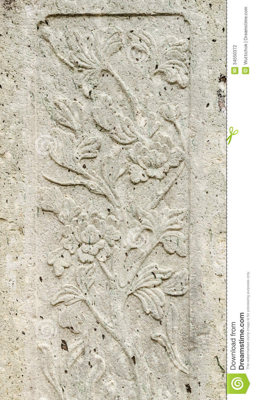 Old stone carving background on temple fence wall stock