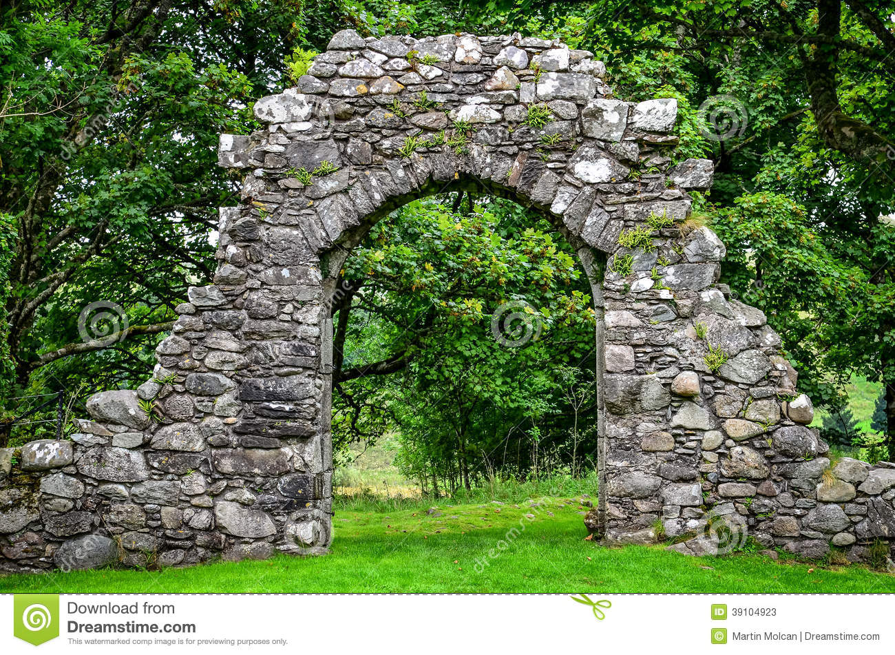 Old Stone Entrance Wall In Green Garden Stock Image