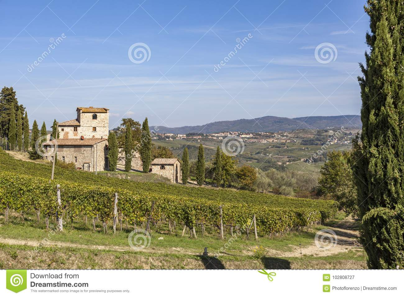 Old stone house on a hill with vineyards in Chianti in Tuscany i