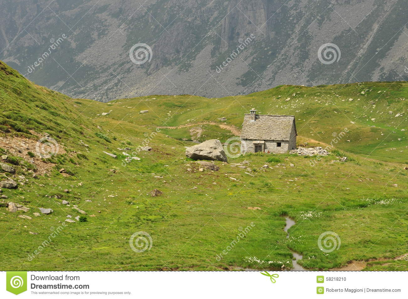 Old stone house and meadow in the italian alps stock photo for Meadow house