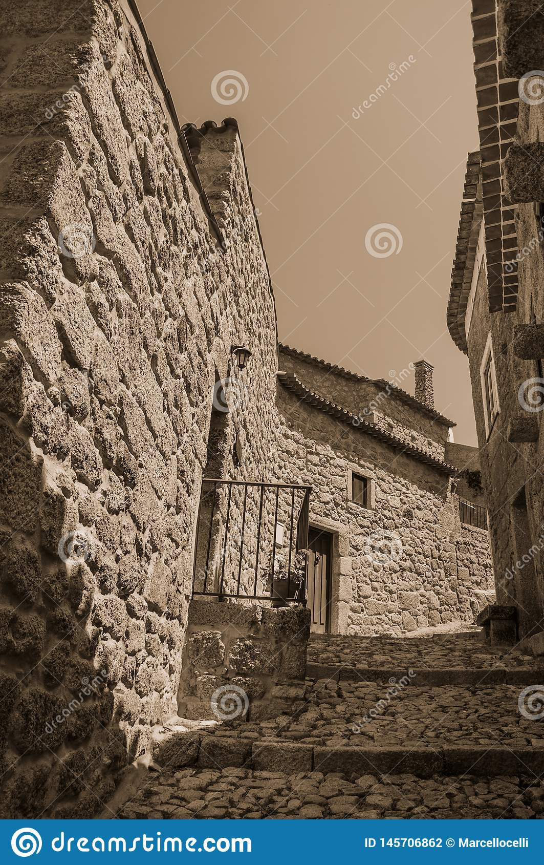 Old stone houses in deserted alley with steps at Monsanto
