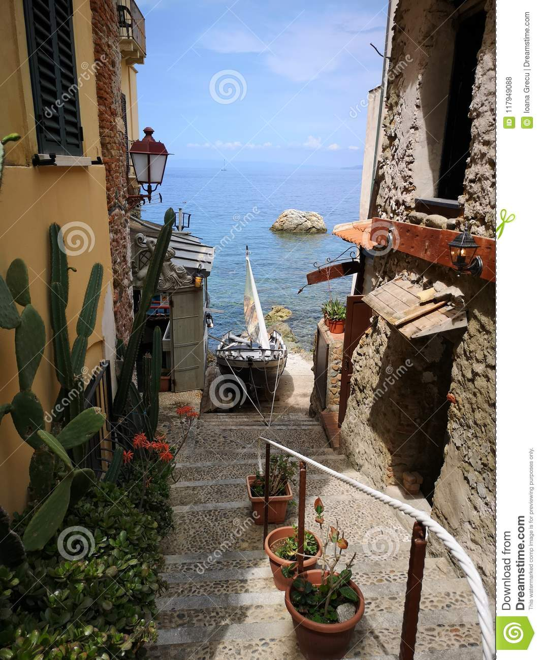 Old stairs going down to the sea in Scilla