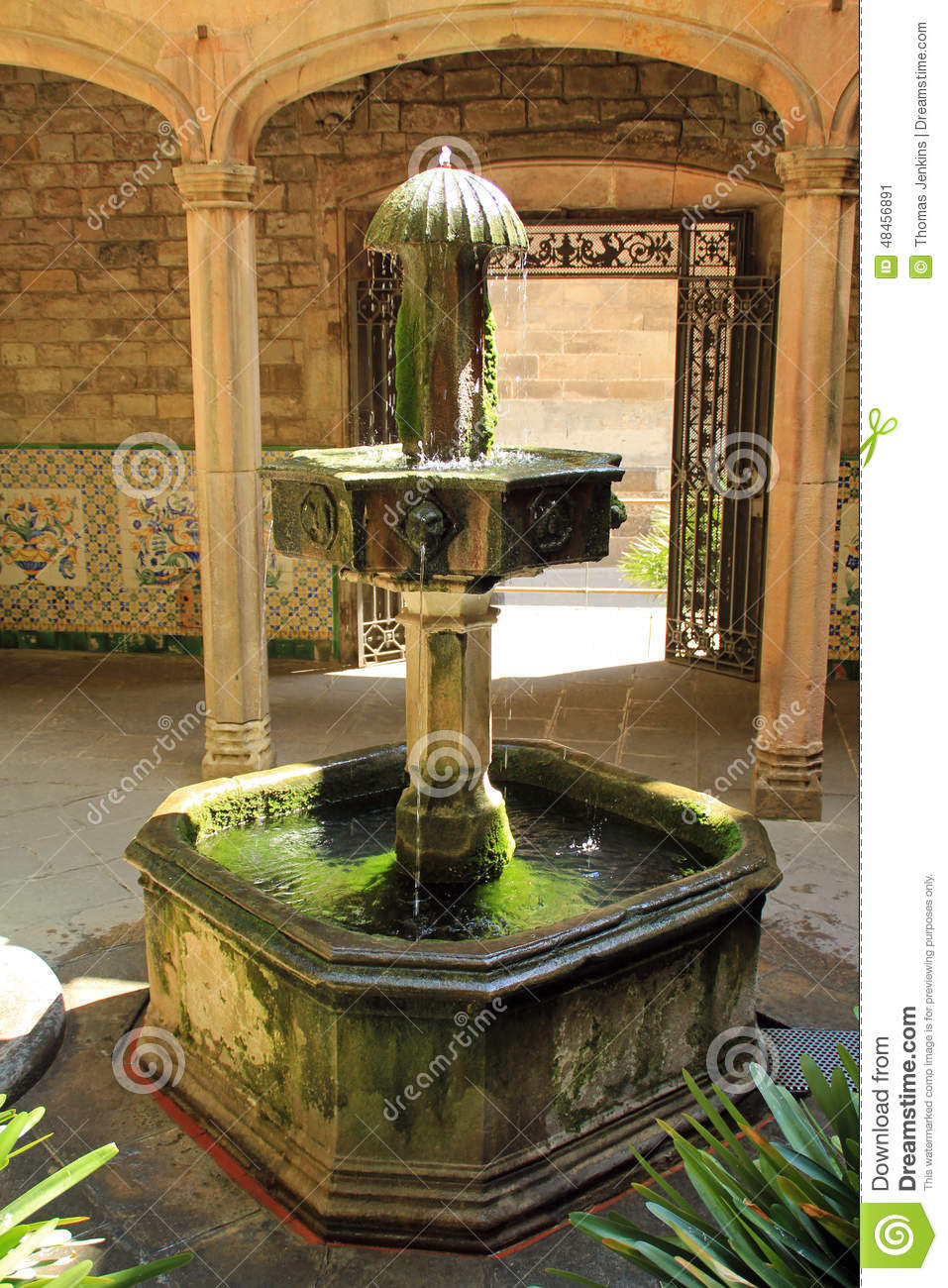 Old Stone Water Fountain At Church Entrance In Barcelona