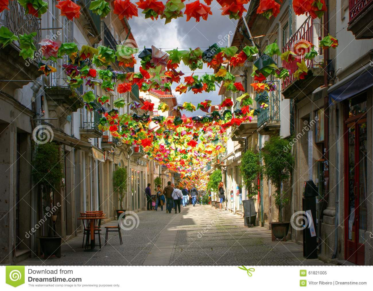 Old street decorated with flowers