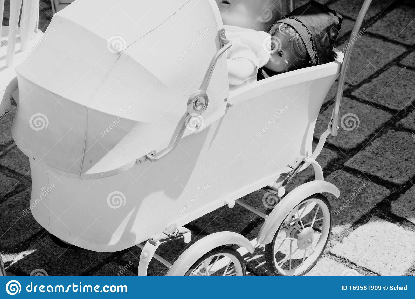 1950s Style Stroller With Doll In Black And White Stock Image