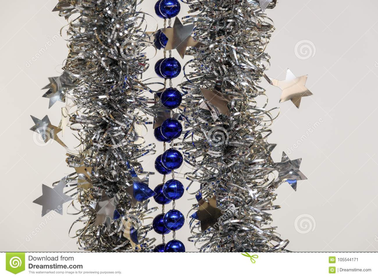 Christmas Tree Decoration Blue Ball And Silver On White Background