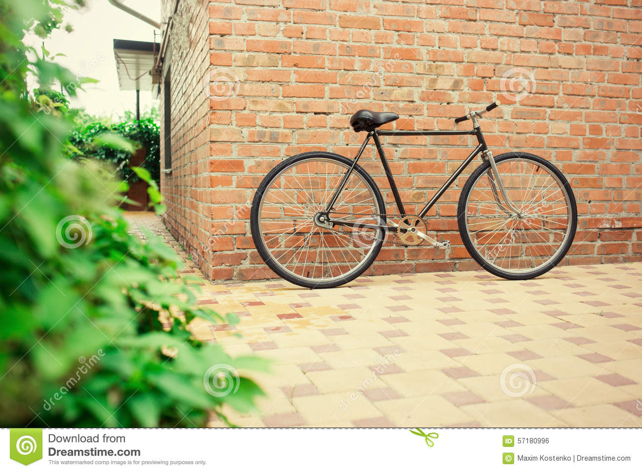 Old style singlespeed bicycle against brick wall