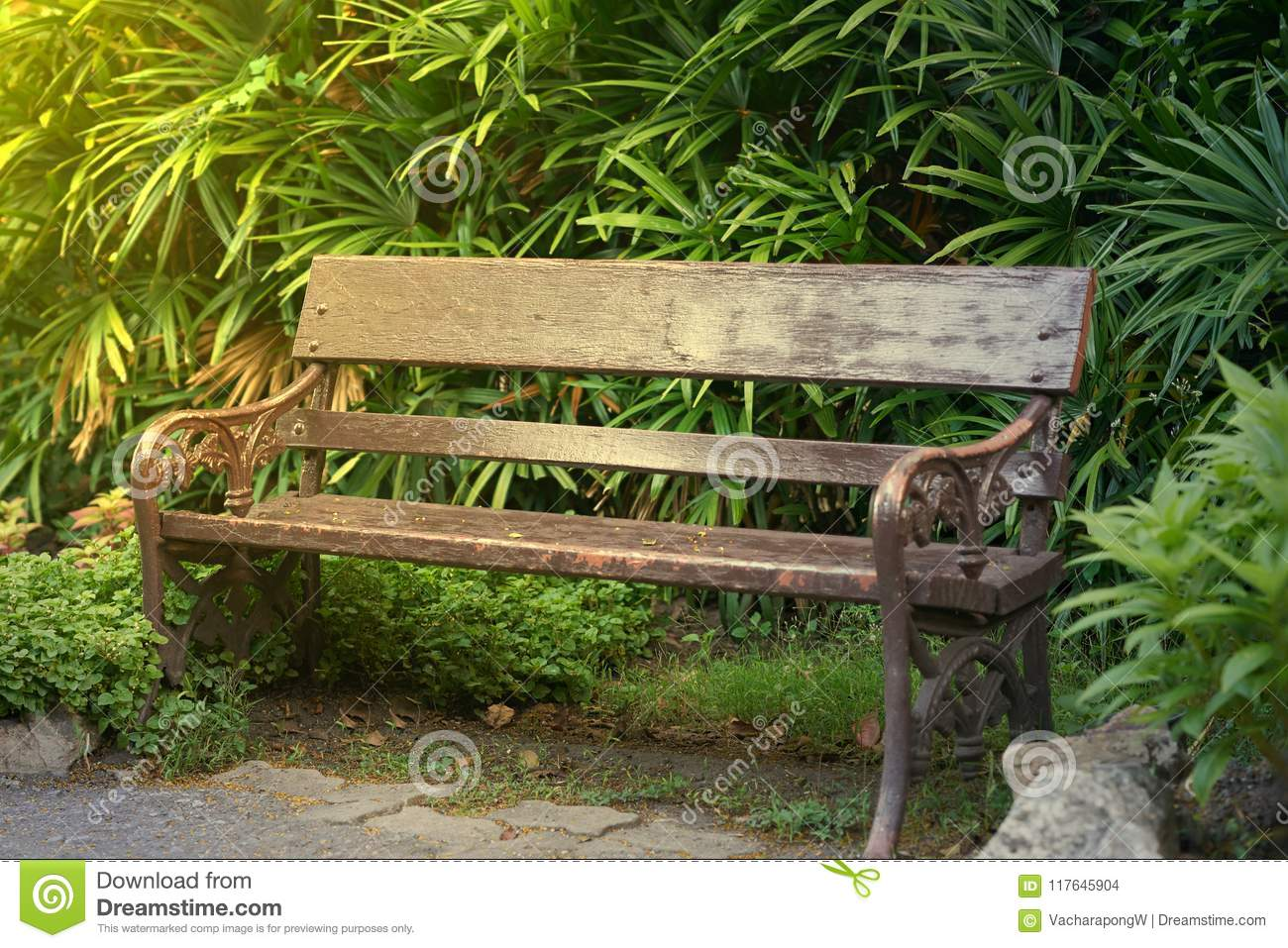 Old Style Vintage Wooden Bench Or Chair In Park With Sunlight Stock