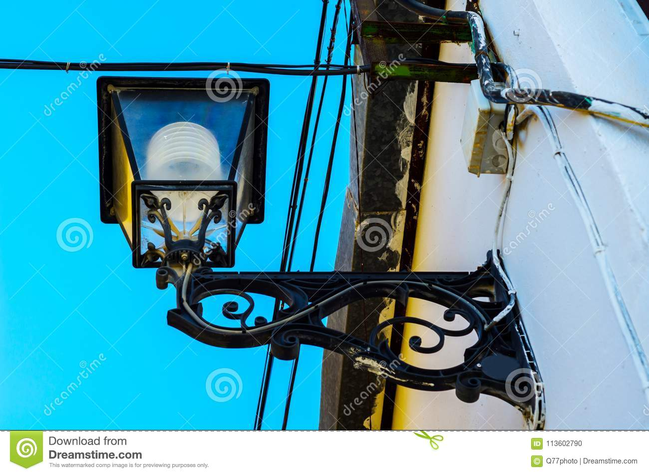 Old Stylish Street Lamp Illuminating The Spanish Street, A ... on electrical repair, electrical contracting, electrical diagrams, electrical grounding, electrical cables, electrical tools, electrical equipment, electrical energy, electrical conduit, electrical shocks, electrical box, electrical fire, electrical engineering, electrical technology, electrical volt, electrical fuses, electrical circuits, electrical receptacle types, electrical cord, electrical wire,