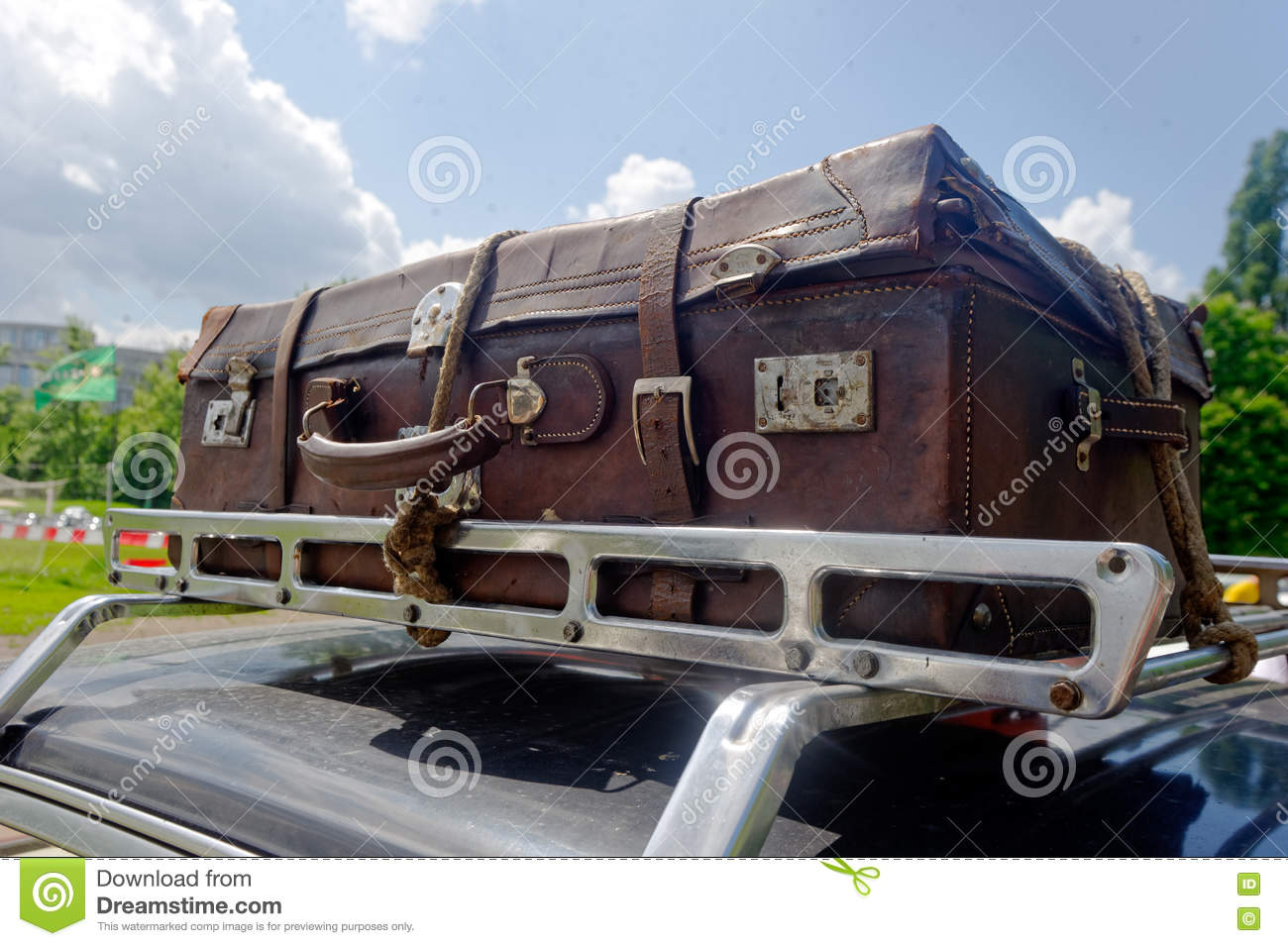 old suitcase on the car roof rack stock photo image 77472962. Black Bedroom Furniture Sets. Home Design Ideas
