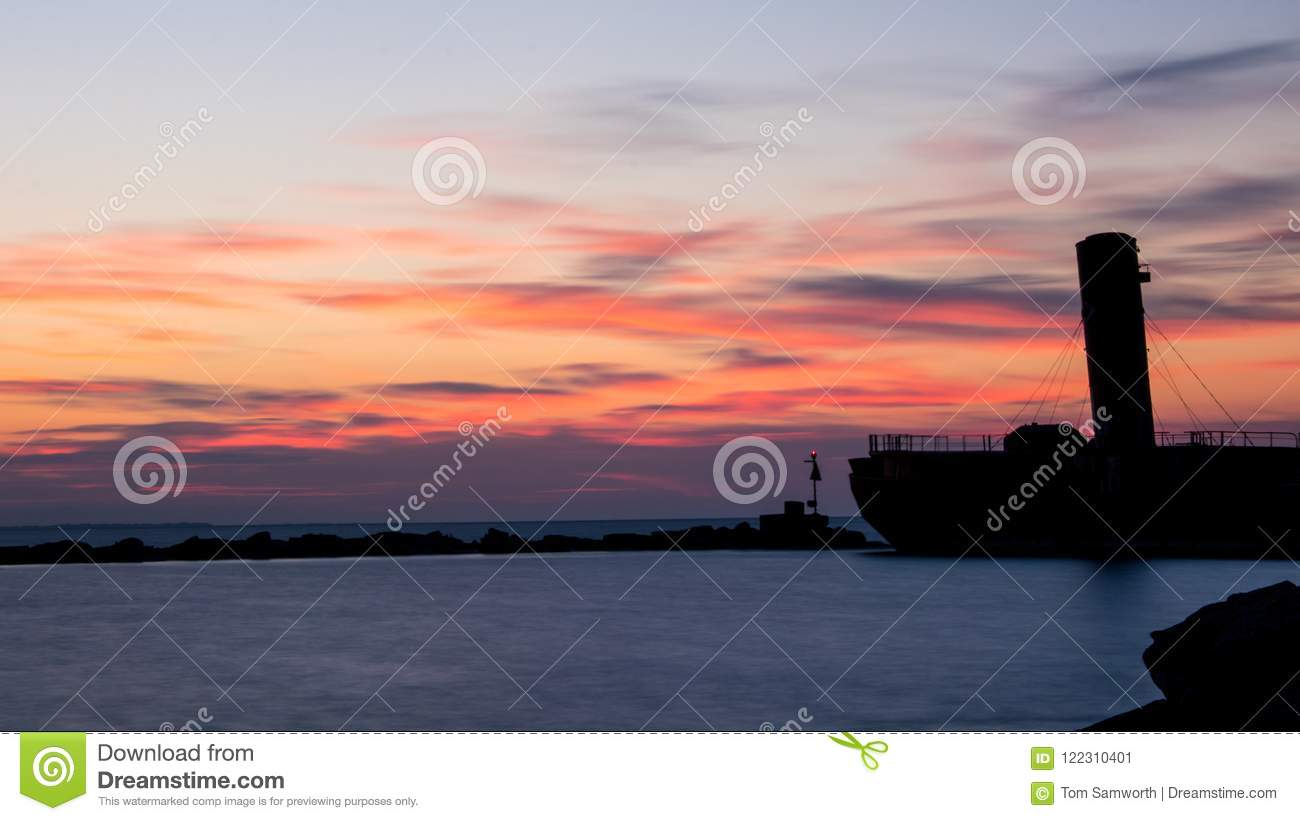 Old Sunken Freighter At Sunrise