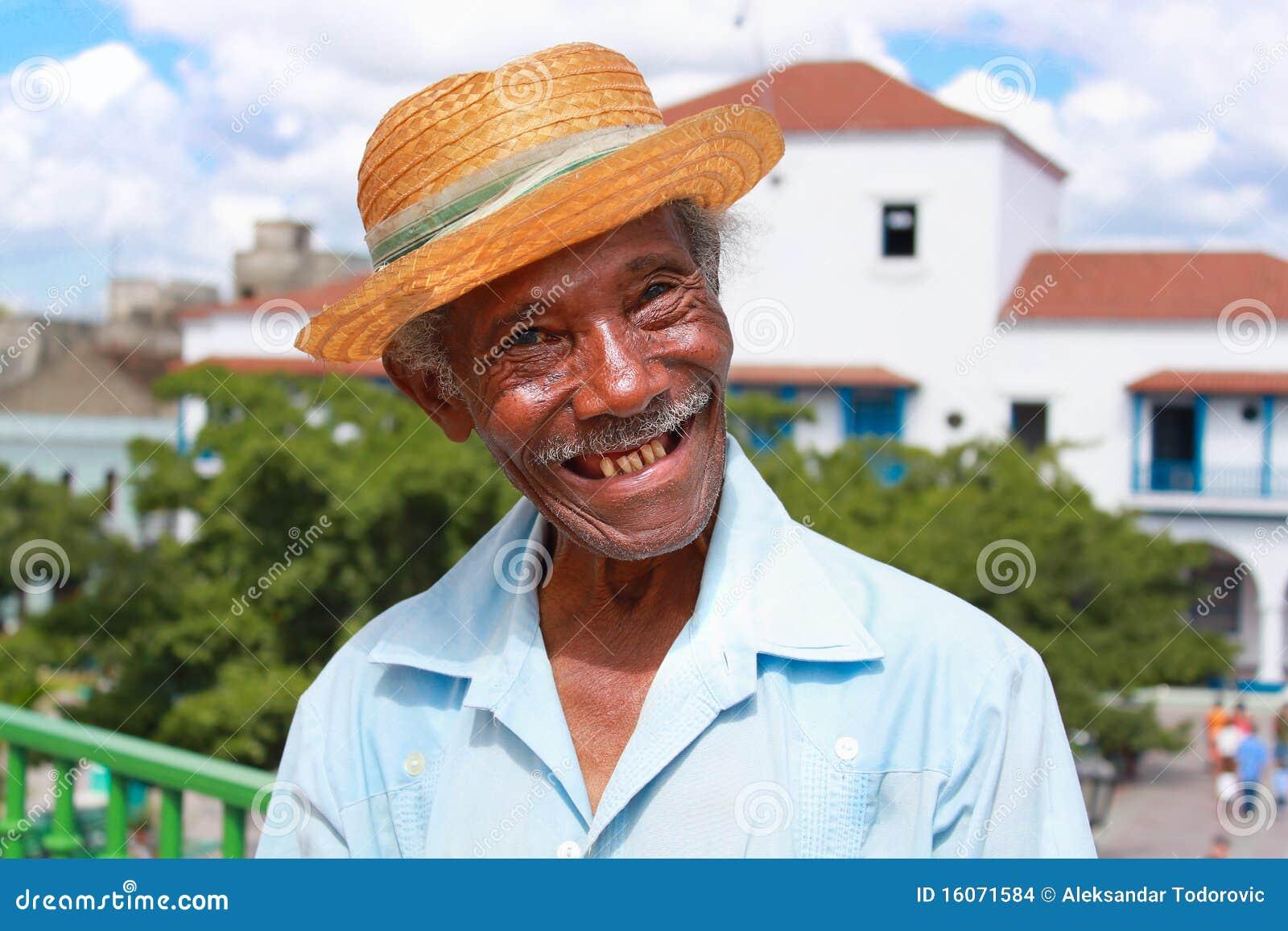 Old sympathetic cuban man with straw hat make a fu