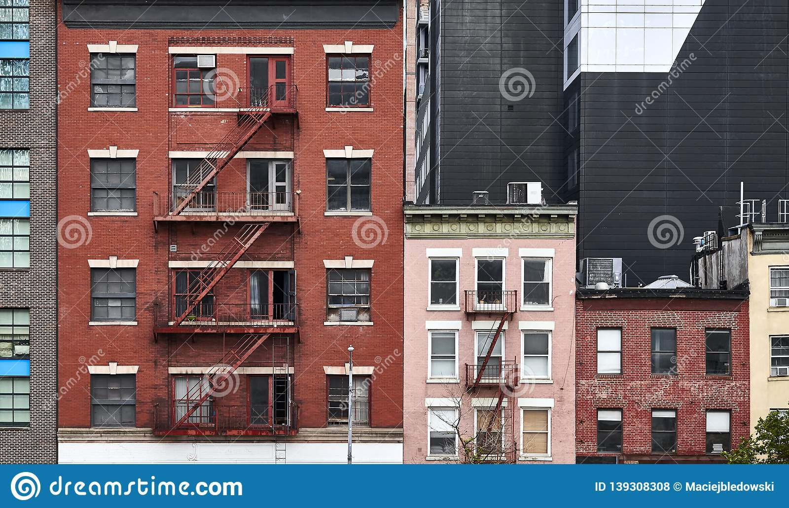 Old tenement houses with fire escapes in New York