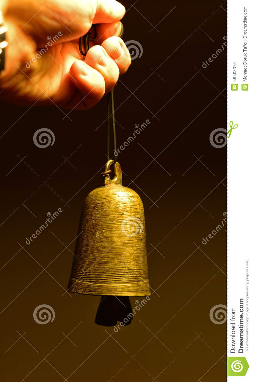 Old time bell in hand
