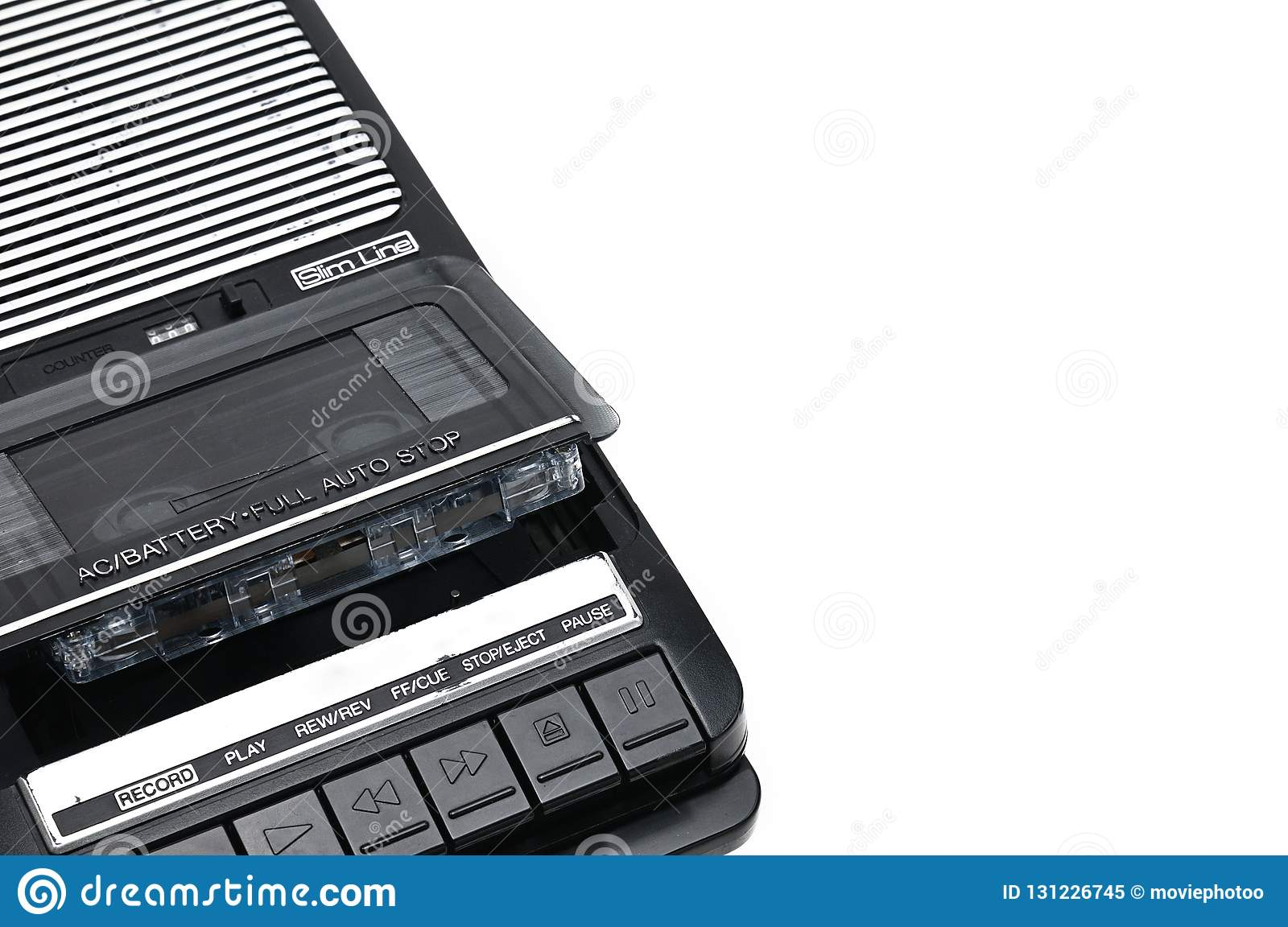 Old-time desktop type cassette recorder on white isolated background