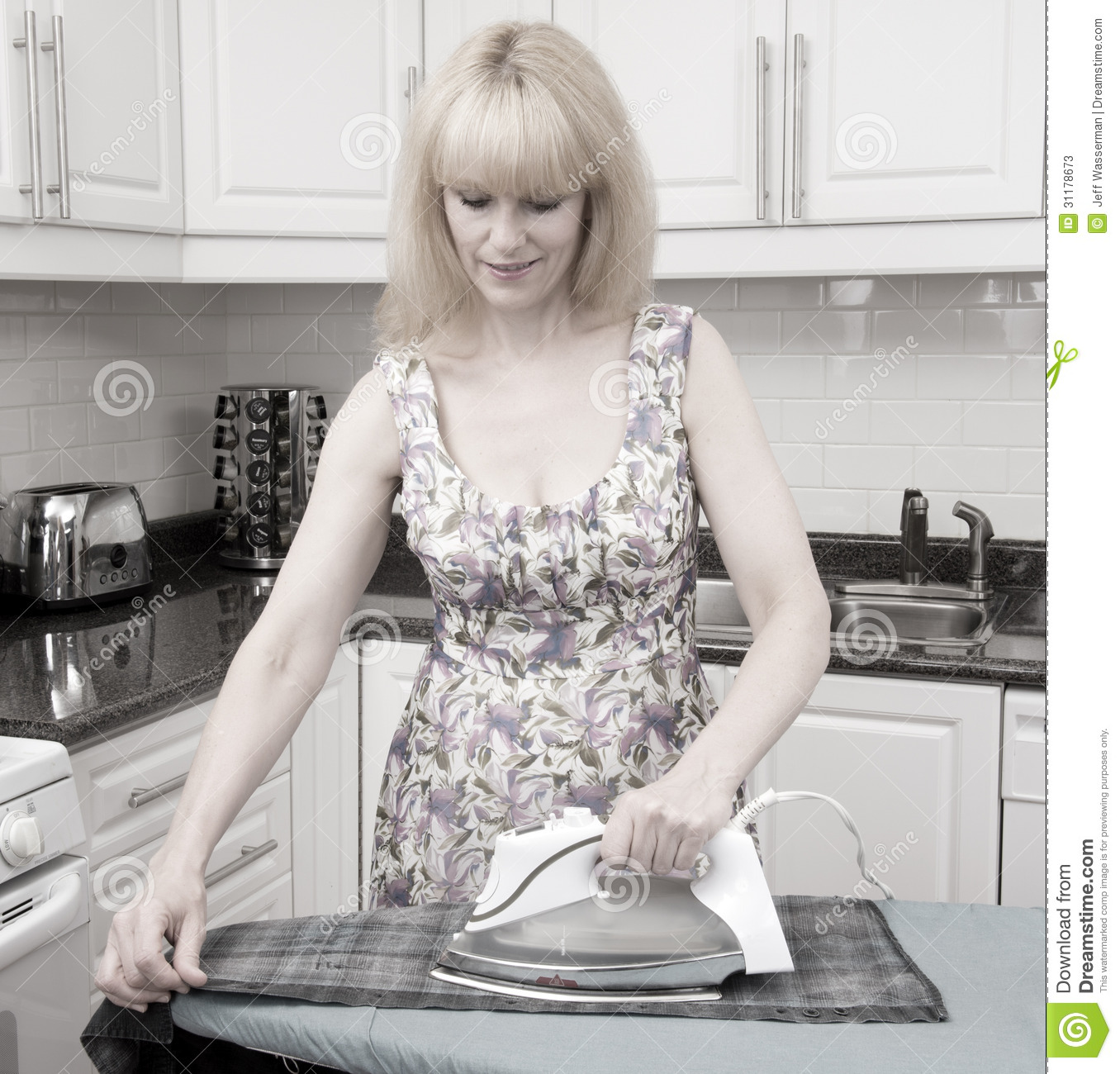 Retro Woman In Kitchen: Old Time Ironing! Stock Photos