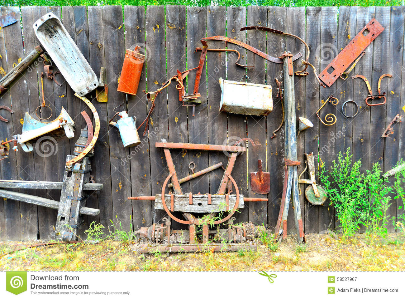 Old tools on a wooden fence