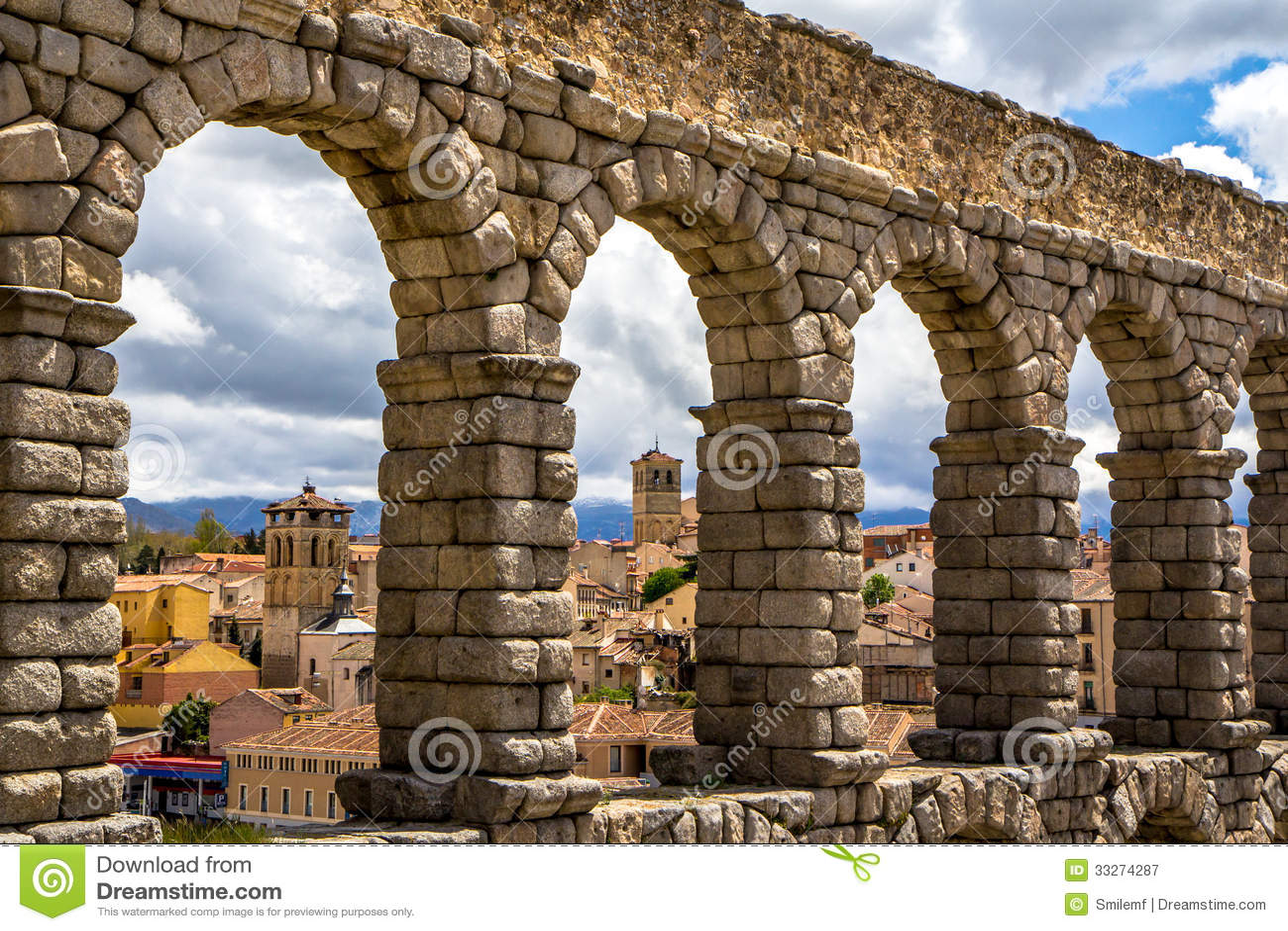 old town of segovia through the roman aqueduct royalty free stock
