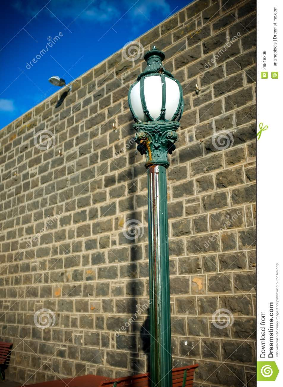 Old Town Street Lamp Post With Wall And Blue Sky Royalty