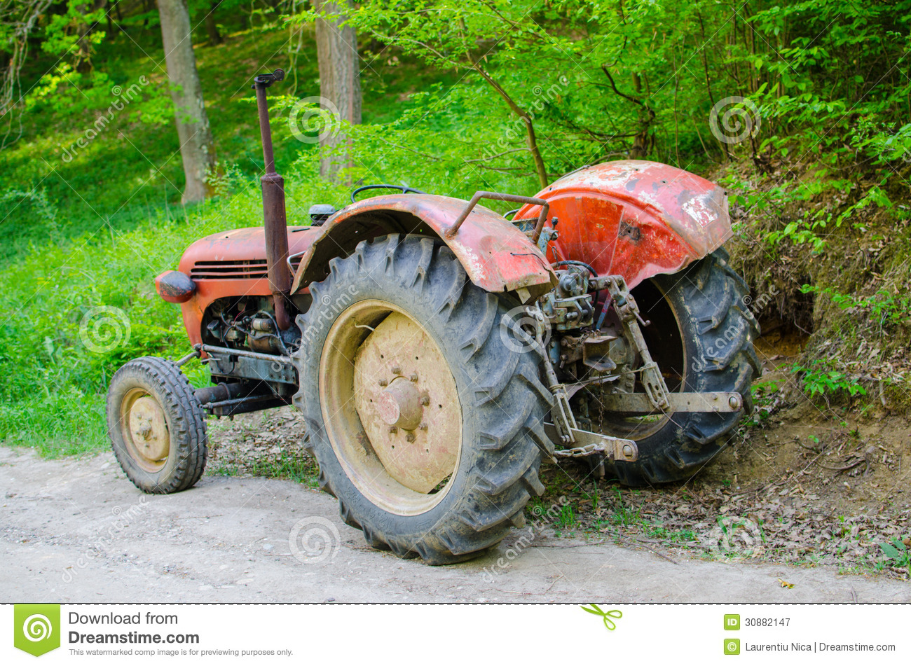 Old Time Tractor Seats : Old tractor on country road stock image