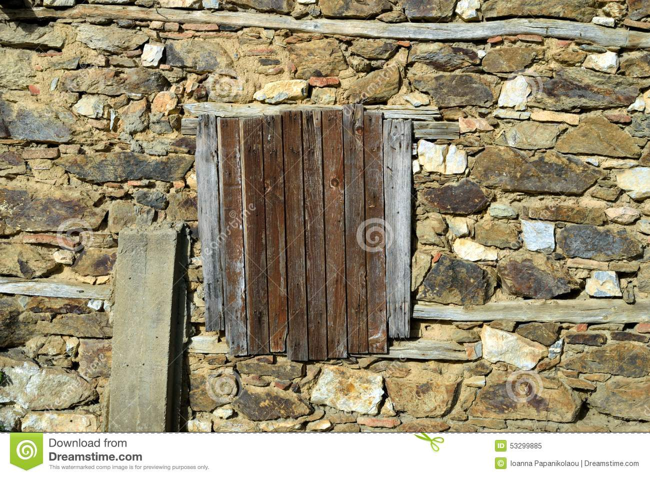 Old traditional window with closed shutters in a ruined for Cobblestone shutters