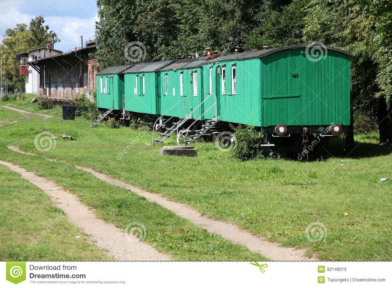 Old train car homes stock image image of green poland for Car carriage