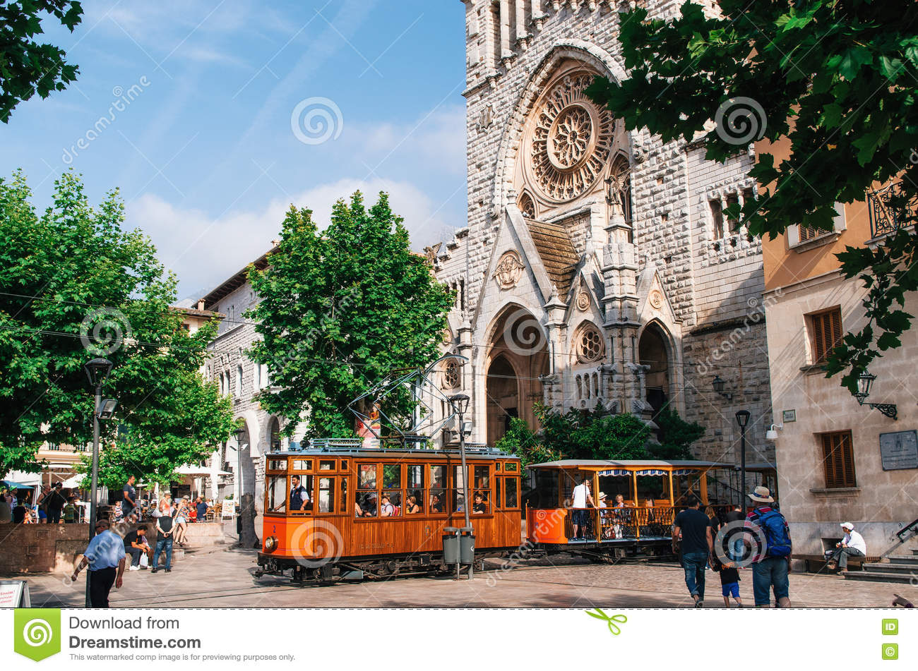 old tram in soller in front of medieval gothic cathedral with huge rose window mallorca spain. Black Bedroom Furniture Sets. Home Design Ideas