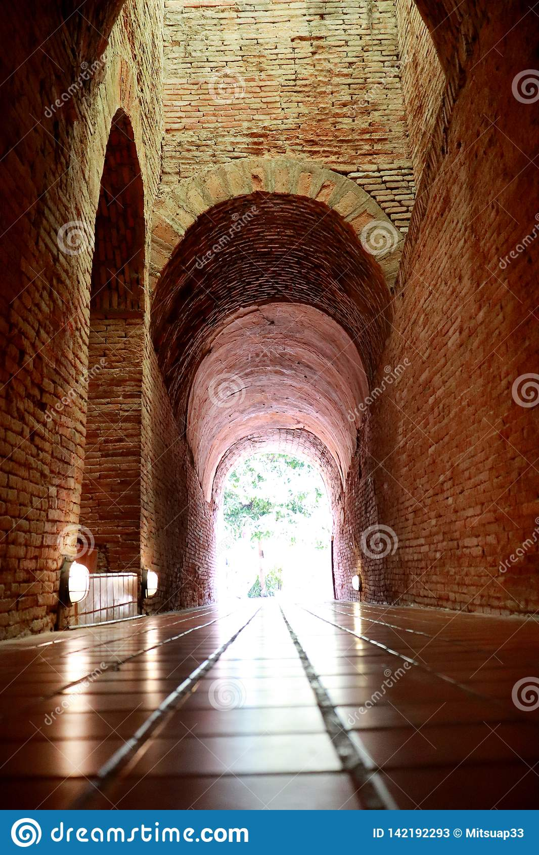 The old tunnel with a light in the end at Wat Umong Changmai Thailand