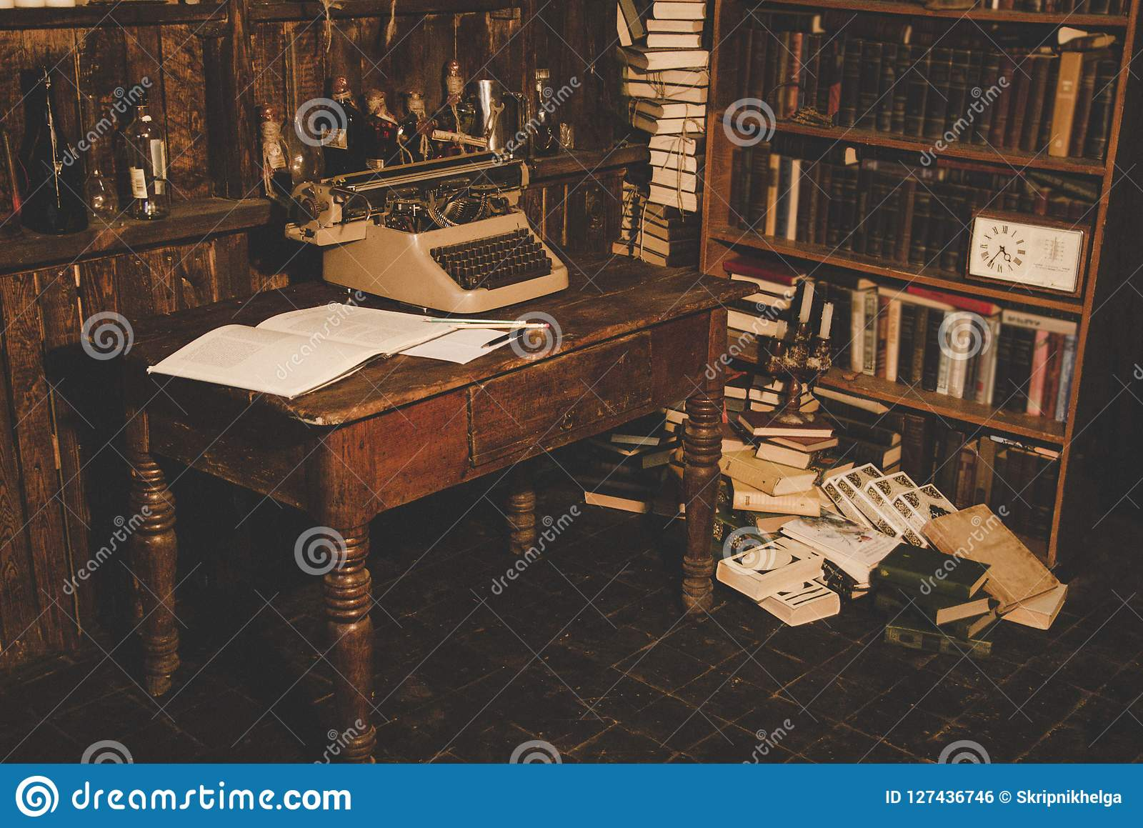 An Old Typewriter Is On The Tablewriters Roomold Books Are On The